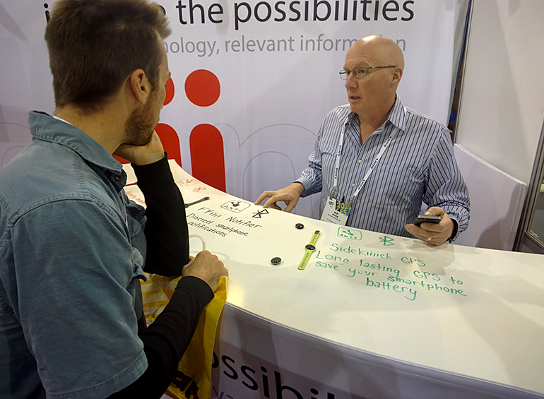 Andrew chats with a representative of a company involved in the product space of a client.